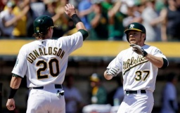 A's win strange game, take series from Mariners